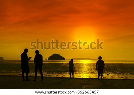 Silhouettes, business people at the Pak Meng beach, Thailand - stock photo