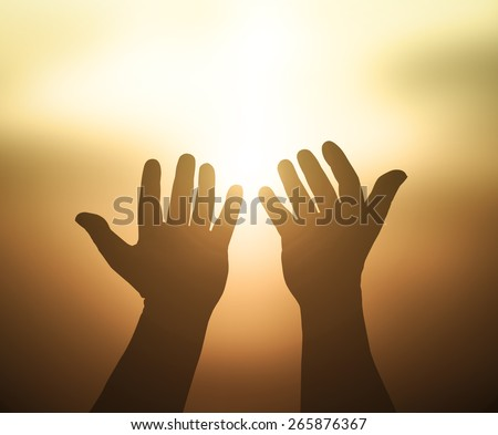 Silhouettes hands of victim boy with rope in emotional stress and pain, afraid, restricted, trapped, call for help, struggle, terrified. People open empty hands and raising hands to ask for something. - stock photo