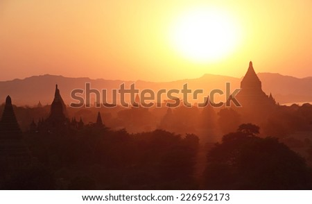 silhouettes of ancient Buddhist Temples after sunset at Bagan, Myanmar - stock photo