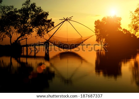 Silhouettes of bamboo machinery for fishing. - stock photo