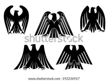 Silhouettes of black eagles for heraldry and tattoo design. Vector version also available in gallery - stock photo