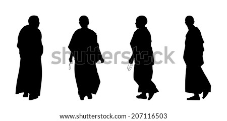 silhouettes of buddhist monks and nuns in traditional clothes walking - stock photo