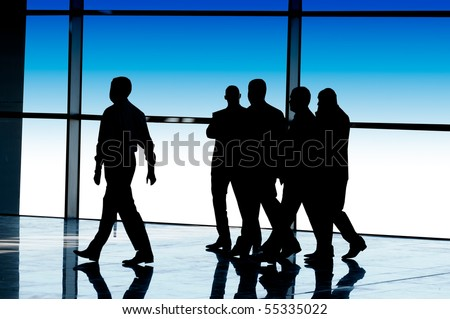 silhouettes of business people - stock photo