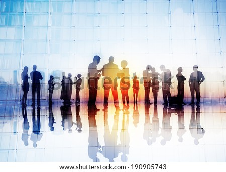 Silhouettes of Business People Discussing Outdoors - stock photo