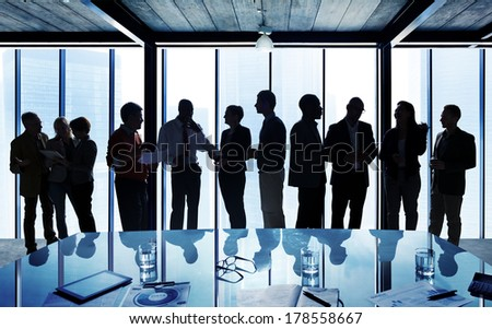 Silhouettes of Business People in a Conference Room - stock photo