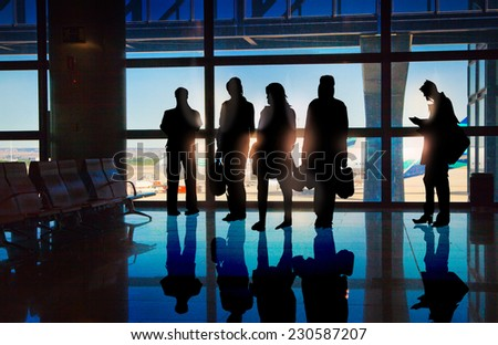 Silhouettes of Business People in the Airport - stock photo