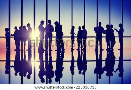 Silhouettes of Business People Working in an Office Building - stock photo