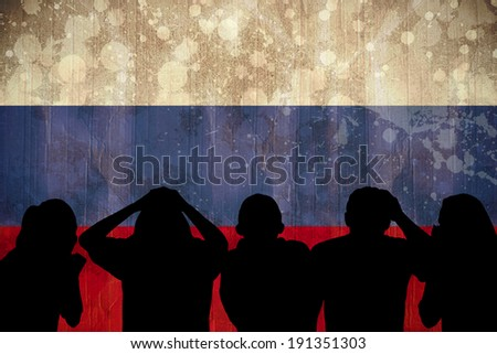 Silhouettes of football supporters against russia flag in grunge effect - stock photo