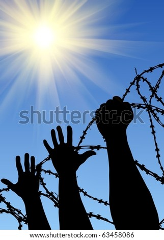 Silhouettes of hands behind a barbed wire - stock photo