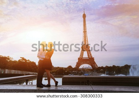 silhouettes of loving couple in Paris - stock photo