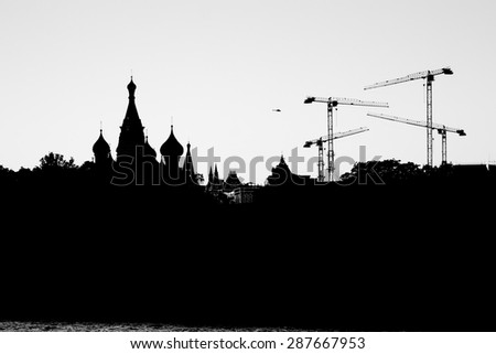 Silhouettes of Moscow Kremlin and St. Basil's Cathedral at Red square/Kremlin silhouette night view - stock photo