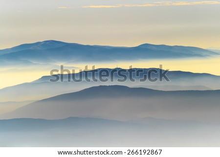 Silhouettes of Mountain Ridges in Autumn - stock photo
