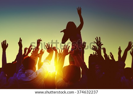 Silhouettes of People at Outdoors Music Festival - stock photo