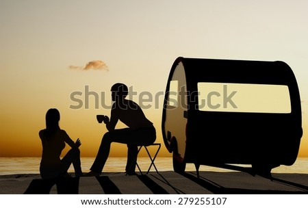Silhouettes of people on the beach. - stock photo