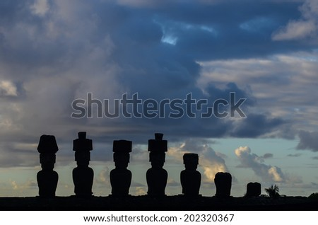 Silhouettes of the Moais from the Ahu Nau Nau, located in a few meters away from the white sands of Anakena beach.Easter Island (Rapa Nui), Isla de Pascua, Region de Valparaiso, Chile. - stock photo