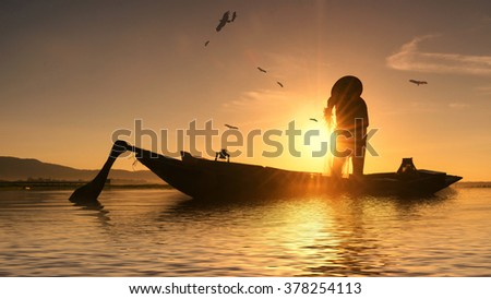 Silhouettes of the traditional stilt fishermen at sunset  - stock photo