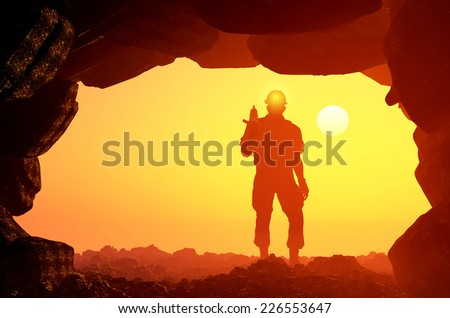 Silhouettes of workers in the mine. - stock photo