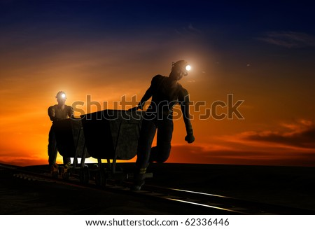 Silhouettes of workers in the night sky. - stock photo