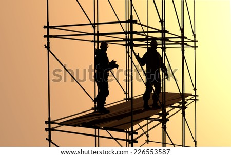 Silhouettes of workers on a background of the sky   - stock photo
