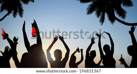 Silhouettes of Young People Celebrating, Drinking on a Beach - stock photo