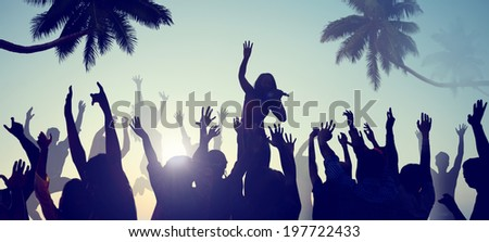 Silhouettes of Young People on a Beach Concert - stock photo
