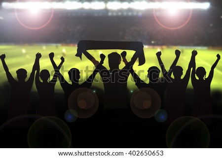 Silhouettes picture of Soccer fans cheering in a match and Spectators at football stadium  - stock photo