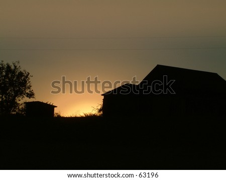 Silhoutte of barn in kentucky - stock photo