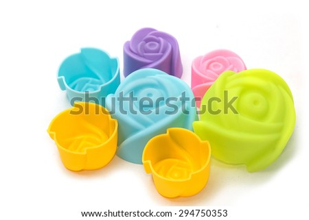 silicone baking cups , silicon cupcake tin isolated white background - stock photo