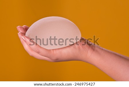 Silicone implants on hand - stock photo