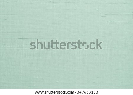 Silk fabric wallpaper texture pattern background in light pale blue green teal color tone: Fine natural raw Thai silk detail textured organic fiber textile backdrop in cyan aqua toned colour     - stock photo