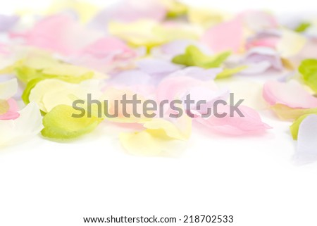 Silk flower petals as a soft pastel background or border for Easter and spring themes.  - stock photo