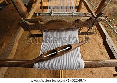 Silk rug weaving on a hand loom in Thailand - stock photo