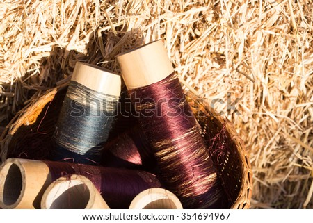 silk threads in a coils on blurred background - stock photo