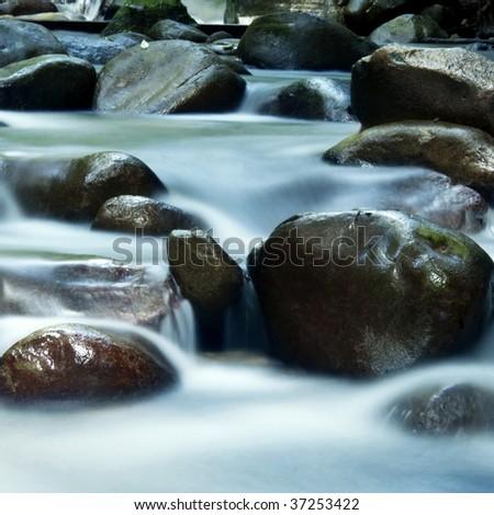 Silky water, zen water flowing. - stock photo