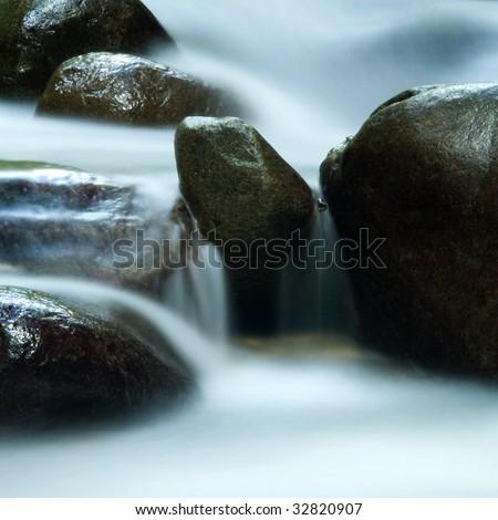 Silky water. Zen water flowing in 25 seconds long exposure. - stock photo