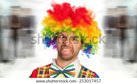 silly clown making a face, studio picture - stock photo
