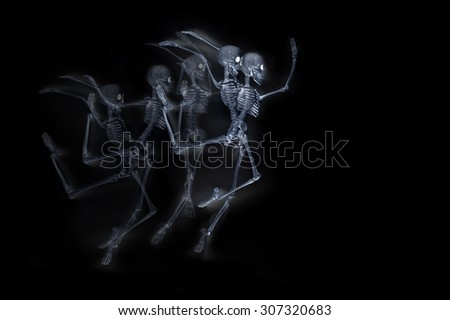 Silly dancing skeletons as seen through an xray machine - stock photo
