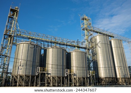 Silo in agricultural factory.  - stock photo