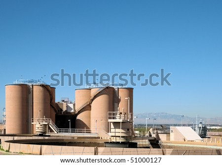Silos at a waste water treatment plant - stock photo