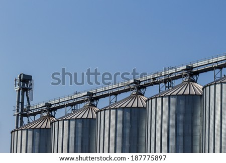 silos for agricultural goods in a warehouse - stock photo