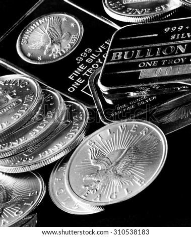Silver American Money coins and bars representing wealth and money  - stock photo