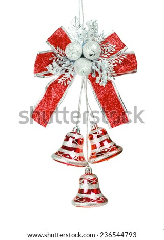 Silver and red bells with a blue bow isolated on white - stock photo