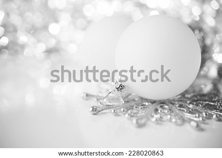 Silver and white christmas decoration on holiday background. Merry christmas card. Winter holidays. Xmas theme. - stock photo
