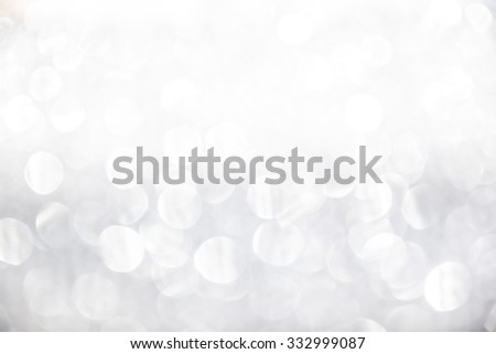 Silver and white Lights Festive Christmas background with texture. Abstract Christmas twinkled bright background with bokeh defocused lights abstract - stock photo