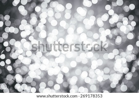 Silver background with natural bokeh defocused sparkling lights. Grey metallic texture with twinkling lights. Bright and vivid colors - stock photo