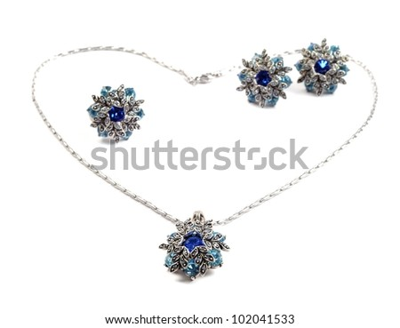 Silver beautiful  set with blue  gems, over white - stock photo