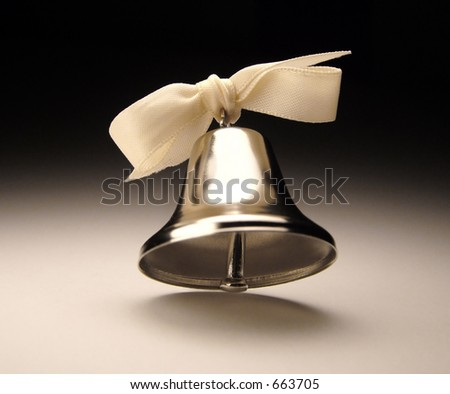 Silver bell with bow. - stock photo