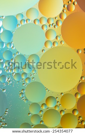 Silver, blue, orange and gold oil and water abstract - stock photo