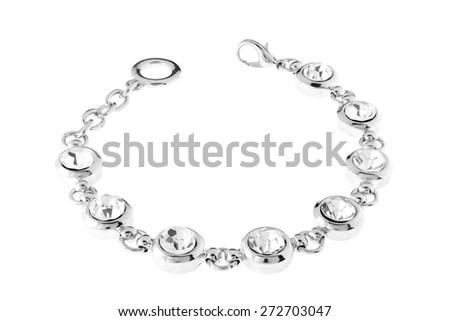 silver bracelet with diamonds on a white background - stock photo