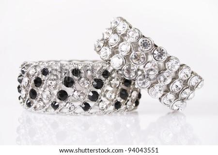 silver bracelets on a white background - stock photo